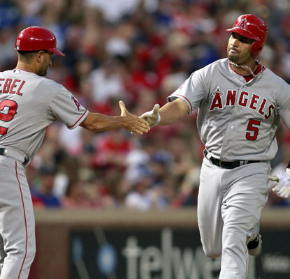 Albert Pujols goes deep twice to reach 20 home runs for the season. He now has 43 career multihomer games.  (US Presswire)