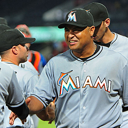 Carlos Lee contributes an RBI single in the Marlins' three-run first inning. (Getty Images)