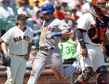 Mets center fielder Andres Torres scores in the fifth inning in between former Giants teammates Barry Zito and Hector Sanchez.  (AP)