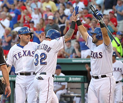 Texas batters celebrate early and often. Ian Kinsler, Josh Hamilton and Geovany Soto do so here in the second inning.  (US Presswire)