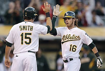 Josh Reddick (16) receives congratulations from Seth Smith after belting a two-run HR in the third inning.  (AP)