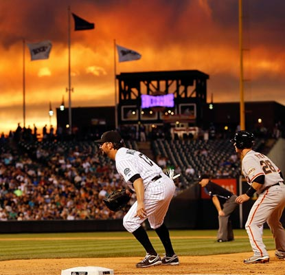 Rockies fans get to see a beautiful sunset, but the game itself is nothing but ugly for the home team.  (Getty Images)
