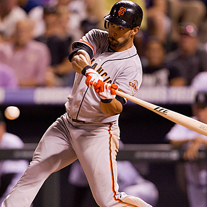 Angel Pagan contributes four hits to the Giants' total of 17 in the game, a season high.  (Getty Images)