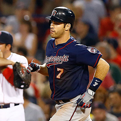 Trailing 4-3 in the ninth inning, Joe Mauer hits a three-run HR to lift the Twins over the Red Sox.  (Getty Images)