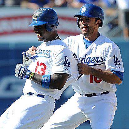 Hanley Ramirez (left) gets congratulations from teammate Andre Ethier after driving in the Dodgers' winning run. (Getty Images)