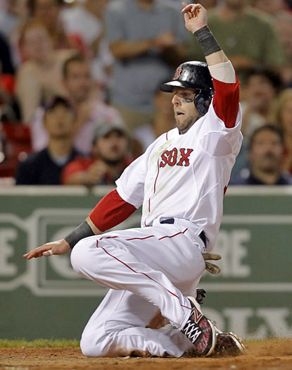 Dustin Pedroia is one of three Boston players to finish with three hits in the victory against Texas. (AP)