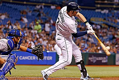 Evan Longoria drives in a run on a bases-loaded sac fly after missing 85 games with a partially torn left hamstring. (Getty Images)