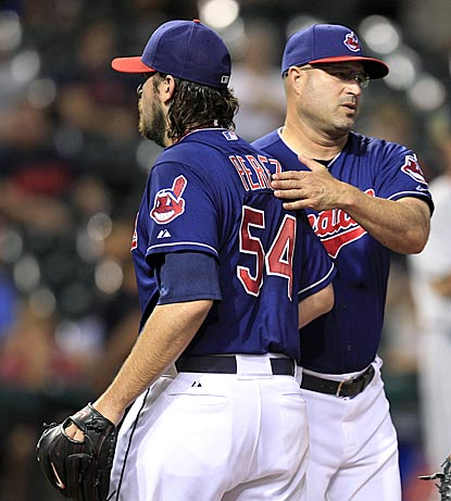 Indians manager Manny Acta tries to comfort closer Chris Perez after his second disastrous outing in a span of three days.  (AP)