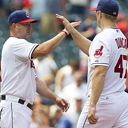 Manager Manny Acta (left) and the Indians win to avoid tying the franchise record for consecutive losses.  (Getty Images)