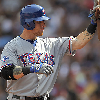 Josh Hamilton homers and knocks in four runs in the  Rangers' victory against the Red Sox. (Getty Images)