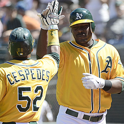 Chris Carter (right) connects on a two-run homer as part of a five-run sixth inning for the A's.  (Getty Images)