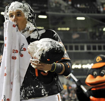 Welcome to the big leagues, Manny Machado. The rookie gets a shaving cream pie to the face after his two-homer game.  (AP)