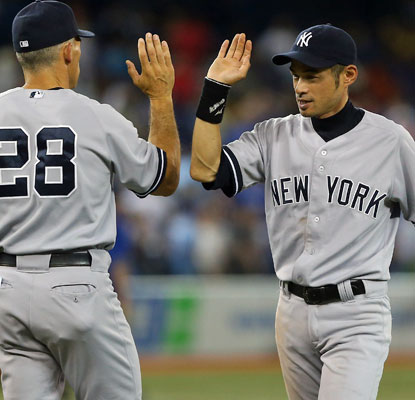 Ichiro Suzuki (right), starting in center field, matches a career-high in RBI he set nearly eight years ago.  (AP)