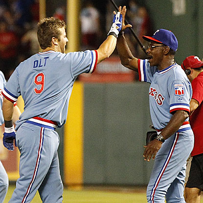 Rangers manager Ron Washington congratulates Mike Olt, who was called up from Double-A on Aug. 1, on his game winner. (Getty Images)