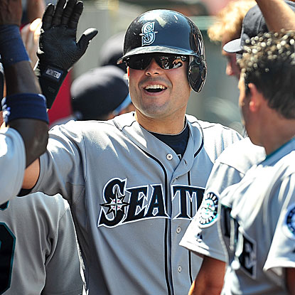 Jesus Montero connects for two homers off the Angels' Jered Weaver, the major league ERA leader, to help lift the M's. (US Presswire)