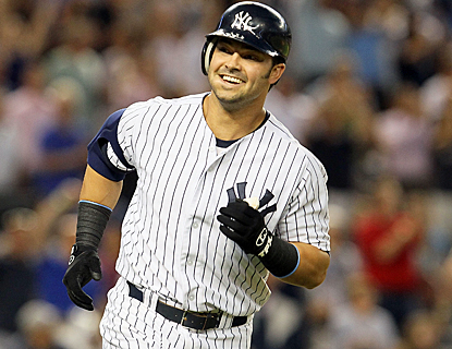 Nick Swisher smiles as he rounds the bases after hitting his grand slam in the third inning. (Getty Images)