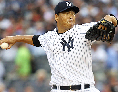Hiroki Kuroda strikes out five Rangers, bringing his strikeout total to 14 for August. (AP)