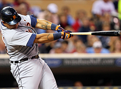 Miguel Cabrera connects for a single -- one of his three hits on the night -- during the fifth inning against the Twins. (US Presswire)