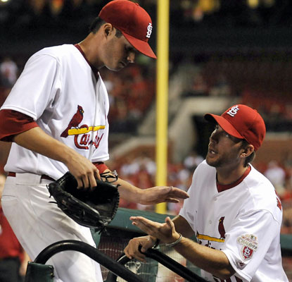 Cardinals rookie Joe Kelly (left) is congratulated by Adam Wainwright after holding down the D-Backs through 6 1/3 innings.  (Getty Images)