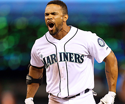 Eric Thames celebrates after helping the Mariners improve to 8-1 in their last nine games at Safeco Field. (Getty Images)