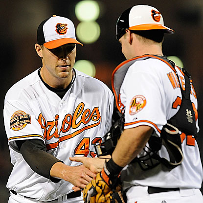 Jim Johnson nails down his 35th save as the O's win and move a game ahead of the Rays for the top AL wild-card spot. (Getty Images)