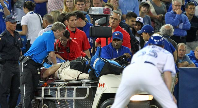 A fan is given CPR after going into cardiac arrest in the seventh inning. (US Presswire)