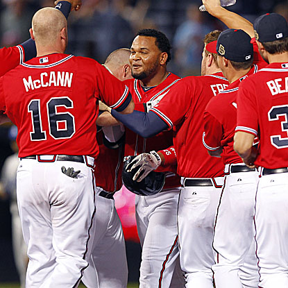 Juan Francisco (center) delivers a two-out pinch-hit single in the 11th inning to give the Braves their fourth straight win. (AP)