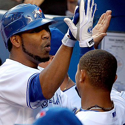 Edwin Encarnacion returns to the lineup after missing one game and homers to help the Blue Jays edge the Rangers. (Getty Images)
