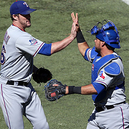 Joe Nathan records his 22nd consecutive save for the Rangers, a new team record. (US Presswire)