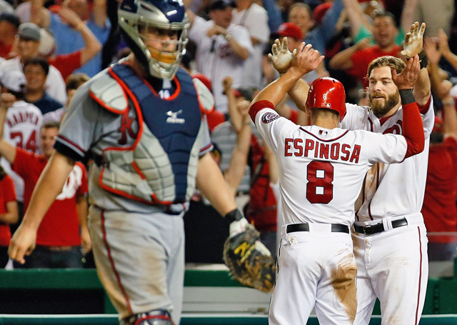 Washington's Danny Espinosa celebrates the winning run with teammate Jayson Werth. (AP)