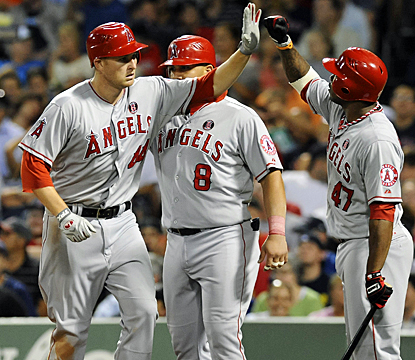 Mark Trumbo (left) goes deep as the Angels look to get themselves back in the playoff picture. (US Presswire)