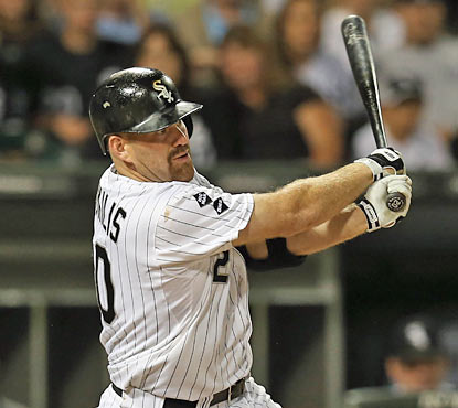 Kevin Youkilis hurts his former rivals with a grand slam in the fifth to blow open the game. (Getty Images)