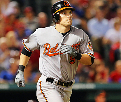 Nate McLouth's homer helps the Orioles stay a game behind the Rays in the wild card race. (US Presswire)