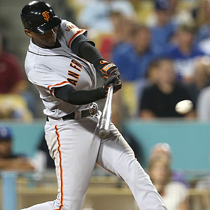 Joaquin Arias doubles, homers and drives in a career-high five runs in the Giants' victory over the Dodgers. (Getty Images)