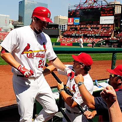David Freese is welcomed back to the Cardinals' dugout after cracking a three-run homer in their win vs. the Astros. (Getty Images)