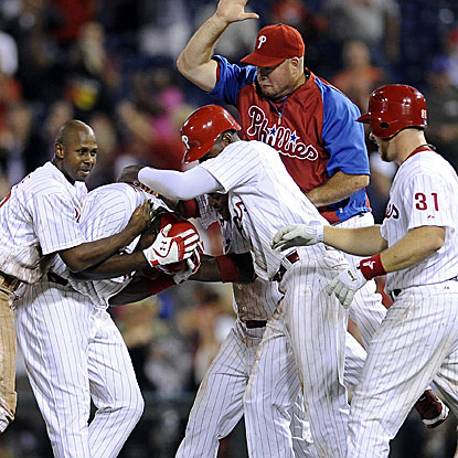 The Phillies get past the Reds in 11 innings thanks to John Mayberry Jr.'s walk-off RBI single. (AP)
