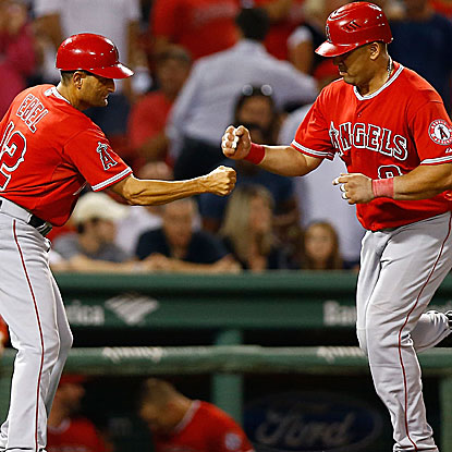Kendrys Morales helps brings the Angels back with a tie-breaking home run in the 10th inning. (Getty Images)