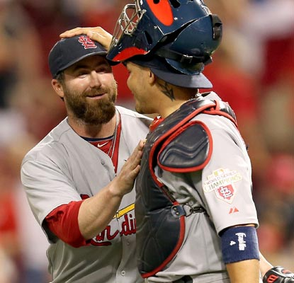 Jason Motte and Yadier Molina celebrate a big win as they begin an important road trip.  (Getty Images)
