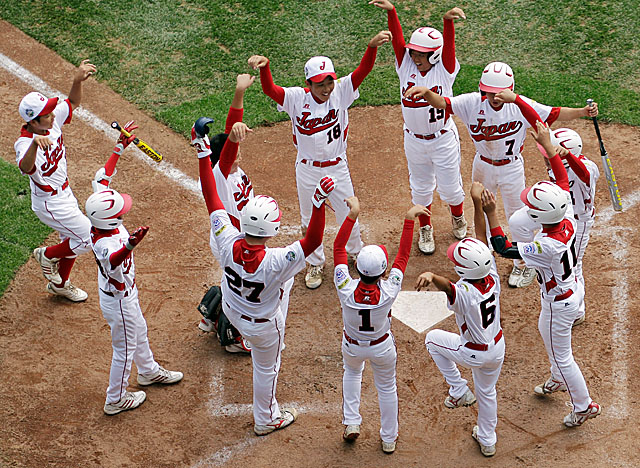 Beasts from the Far East: Japan celebrates in Beast Mode after a fourth-inning home run. (Getty Images)
