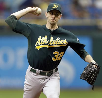 Brandon McCarthy yields two runs in seven innings to improve his record to 9-0 against the AL East since 2009.  (AP)