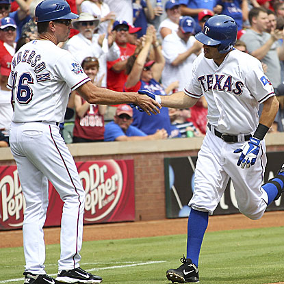 Ian Kinsler homers in the first inning and hits a three-run triple in the third to help stake the Rangers to an early 9-0 lead. (Getty Images)