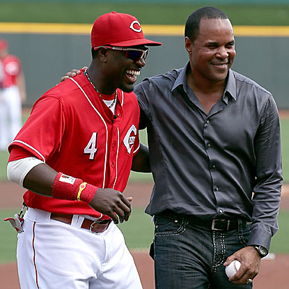 Brandon Phillips catches the ceremonial first pitch thrown out by Barry Larkin and then collects three hits in the Reds' win. (Getty Images)