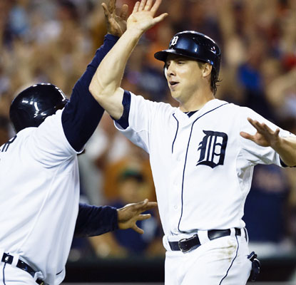 Prince Fielder (left) and Andy Dirks celebrate during a three-run eighth inning that puts the Tigers ahead.  (US Presswire)