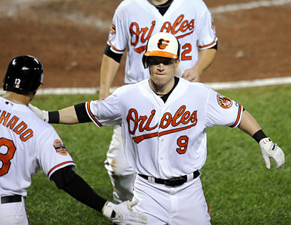The O's Nate McLouth drives in two with a home run in the eighth to help end the White Sox's six-game win streak. (AP)