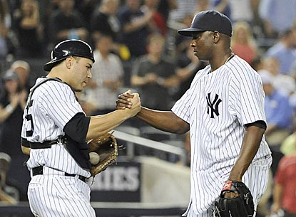 Yankees catcher Russell Martin congratulates closer Rafael Soriano after a 1-2-3 ninth inning for his 34th save.  (AP)