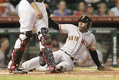 San Francisco's Joaquin Arias slides home with the winning run moments after driving in the tying run with a double.  (Getty Images)