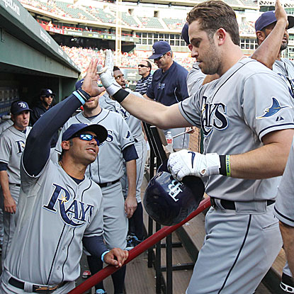 Evan Longoria homers twice, a two-run shot in the first inning and a solo job in the ninth, to help the Rays beat the Rangers. (Getty Images)