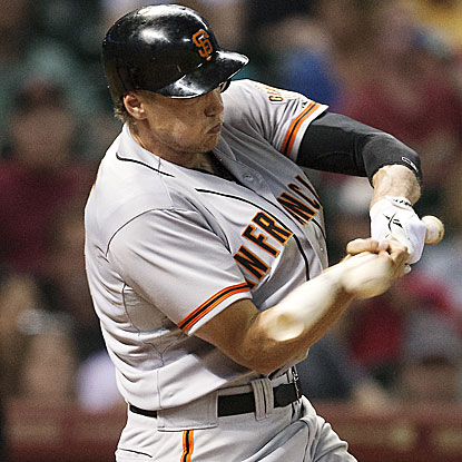 Hunter Pence delivers a go-ahead two-run single in the seventh inning to help the Giants overcome an earlier 4-0 deficit.  (Getty Images)