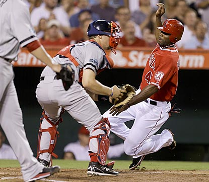 Angels outfielder Torii Hunter scores past Boston catcher Ryan Lavarnway on Mark Trumbo's single in the third inning.  (AP)