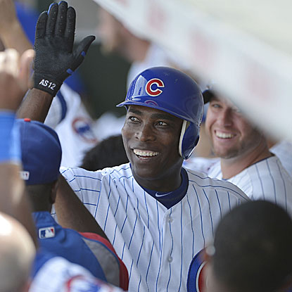 Alfonso Soriano drives in three runs in the Cubs' win, two via a HR that leaves Wrigley Field and lands on Waveland Avenue. (Getty Images)